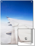 Wing of a Boeing 747 over a Brilliant Blue Sky
