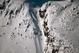 Person Snowboarding Down Chute at Eaglecrest Ski Resort Douglas Isl Near Juneau Alaska Se Winter