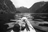 Supplies on the End of a Kayak Going Through a Fjord; Doubtful Sound South Island New Zealand