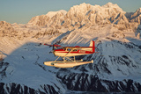 View of a Cessna 185 Floatplane in Alaska Range over Ruth Glacier at Sunset  Southcentral Alaska