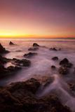 California  Malibu  Sunset over Rocky Ocean Coastline