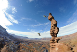 Two People Base Jump Off a Sandstone Spire at the Fisher Towers in Castle Valley  Utah