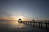 Newlyweds Walk Along a Pier on the West Coast of Cozumel Island