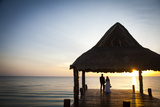 Newlyweds Watch the Sunset after their Beach Wedding on the West Coast of Cozumel Island