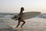 Young Girl with Surfboard; Costa De La Luz Andalusia Spain