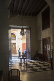 Hotel Employees Chat at the Entrance of the Hostal Palacio O'Farrill in Old Havana