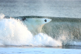 A Surfer Falls into a Winter Wave Off the Coast of Maine