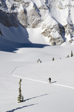 Two Skiers Skin Through a Snowy Expanse Up to Mt Sopris  Colorado