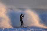 A Surfer Rides a Winter Wave Off the Coast of Maine