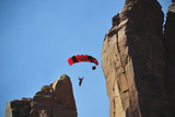 A Woman Parachutes after Base Jumping Off a Desert Spire at Fisher Towers