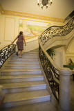 A Tourist Ascends the Staircase at the Hotel San Miguel in Havana Vieja