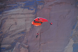 A Person Parachutes after Base Jumping Off a Desert Spire at the Fisher Towers