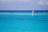 A Lone Sailboat in Turquoise Caribbean Waters Just Offshore