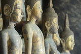A Row of Standing Buddha Images at Wat Visoun  Commonly known as That Makmo