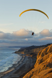 California  La Jolla  Paraglider Flying over Ocean Cliffs at Sunset Editorial Use Only