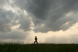A Teenage Girl Runs in a Grassy Field Near Loma  Nebraska