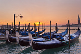 The Sun Rises Beyond Docked Gondolas at Saint Mark's Square in Venice