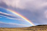 A Thunderstorm Produces a Vivid Rainbow