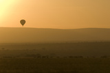 A Hot Air Balloon Safari over Herds of Migrating Wildebeests on the Maasai Mara Plains