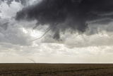 A Long  Snake-Like  Tornado Spins across Cropland