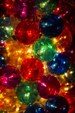 A Stack of Colorful Illuminated Christmas Ornaments