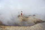 A Man Between Two Craters That Contain Boiling Mud and Steam