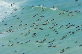 Surfers Make an Attempt to Capture the World Record for the Number of Surfers Riding a Single Wave