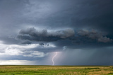 A Positive Cloud-To-Ground Bolt of Lightning Strikes Beneath a Thunderstorm