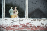 A Figurine of Jack and Jill Sits in a Weathered Window