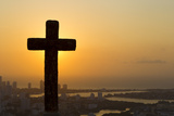 A Cross with the Cartagena Skyline in the Distance at Sunset