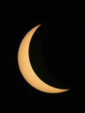 Partial Phase of a Solar Eclipse Photographed Through a Telescope