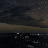 A Meteor Appears Next to the Beehive Star Cluster (M44) Above La Silla Telescope Domes