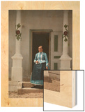A Peasant Woman Poses on the Steps in Front of Her Farmhouse