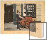 A Postman Delivers Packages with His Parcel Post Barrow