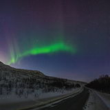View of the Aurora Borealis  Northern Lights  over a Road