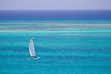 A Sailboat in the Turquoise Waters of the Caribbean Sea