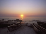 Canoes and Fishing Boats on Beach by Lake Malawi  Sunset