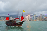 A Boat Named Aqualuna in Victoria Harbor with the Hong Kong Skyline in the Distance