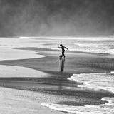 A Young Boy Kicks a Ball on Itamambuca Beach in Ubatuba  Brazil