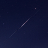 An Iridium Satellite's Flare in the Night Sky