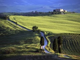 Looking Down Road at Dusk to Old Farmhouse on Hill Top Near Village of Pienza
