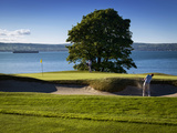 A Man Plays Golf at the Royal Belfast Golf Club at Cultra in Northern Ireland