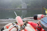 Lobster Trap Buoys and Distant Bdoathouse in Fog  New Harbor  Maine  USA