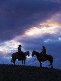 Cowboys in Silouette with Sunset