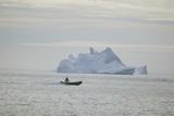 Zodiac Boat near an Iceberg