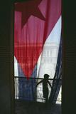 Boy Standing by Cuban Flag