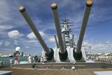 Tourists Looking at Gun Turret on Battleship Missouri