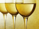 Three Stemmed Gasses of White Wine