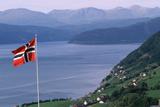 Norwegian Flag Flies above Valley