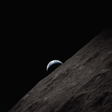 Crescent Earth Rising Behind the Moon